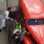 Four of us getting into one of Cuba's classic American cars.